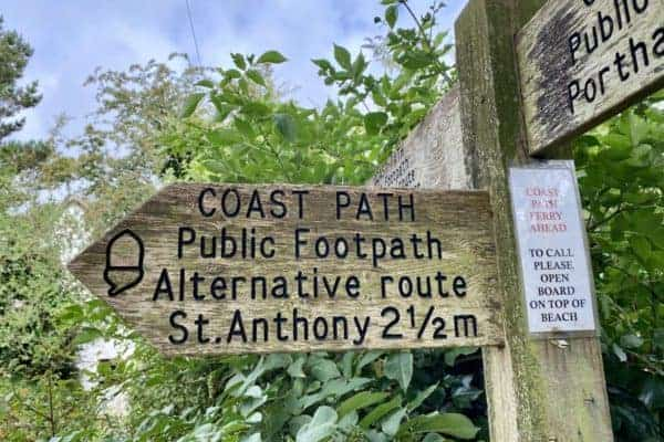 A National Trust sign for coast path to St Anthony