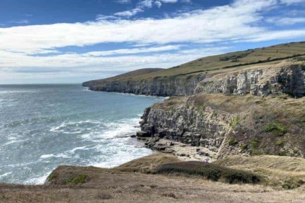 Coastline with blue skies, rocks and sea